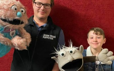 Puppeteer Jason Triggs and young charge Riley Wooster